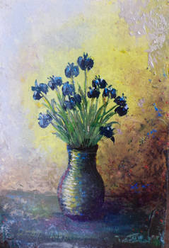 Miniature with a blue flowers