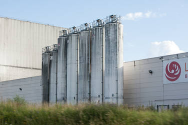 Highway industrial complex silos by ISOStock