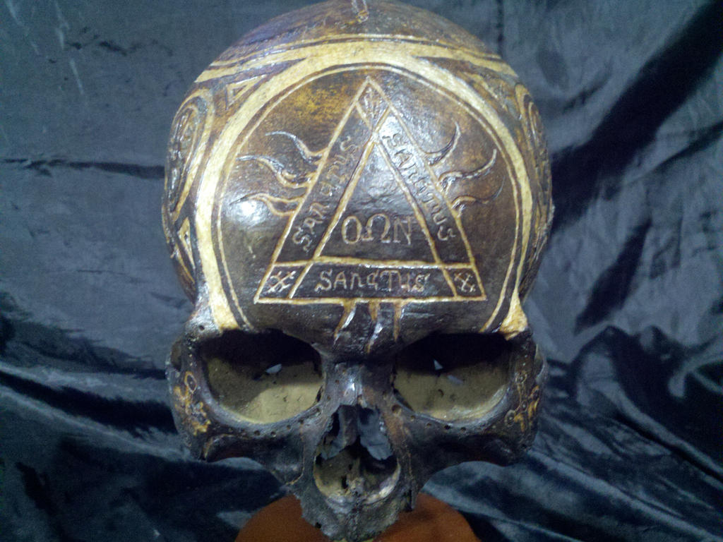 Religious carved skull with designs from catecombs by