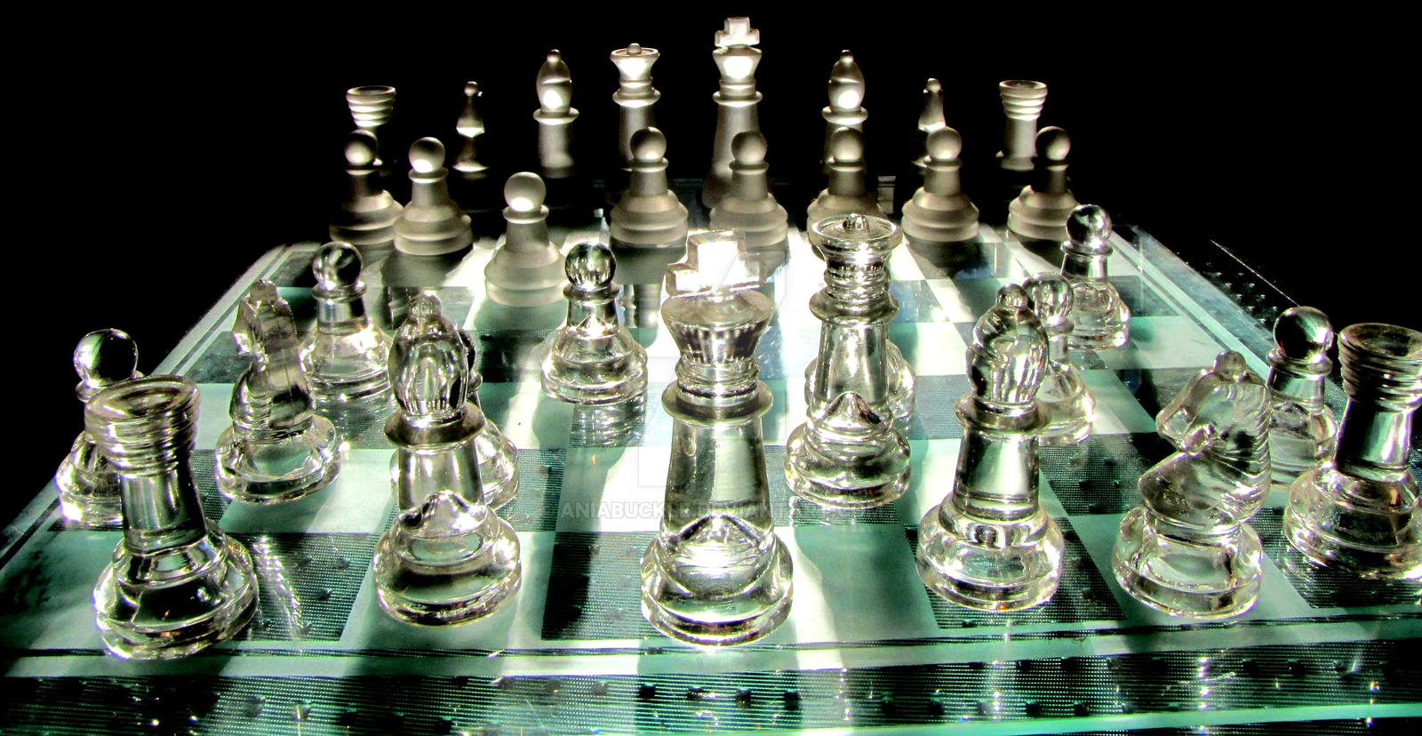 Glass Chess Set Shown At An Angle A Frosted Glass Chess