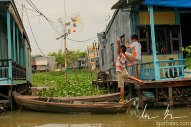 Boys Flying Home Made Kite in Floating Village by kaitou-ace