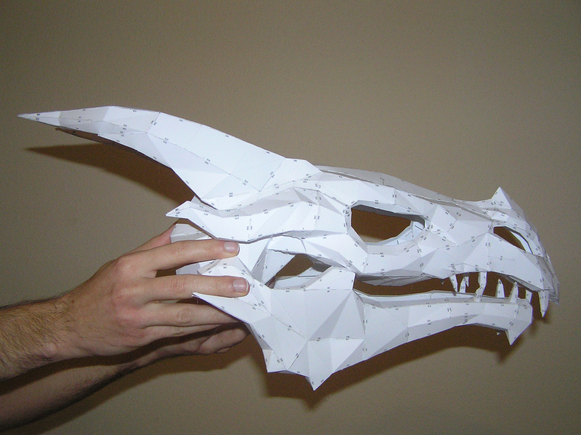 Pepakura skyrim dragon skull 1 by distressfasirt on for Cardboard dragon template