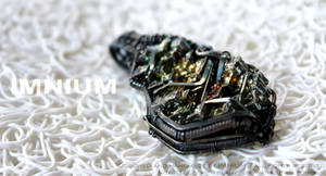 Liquid metal pendant by IMNIUM