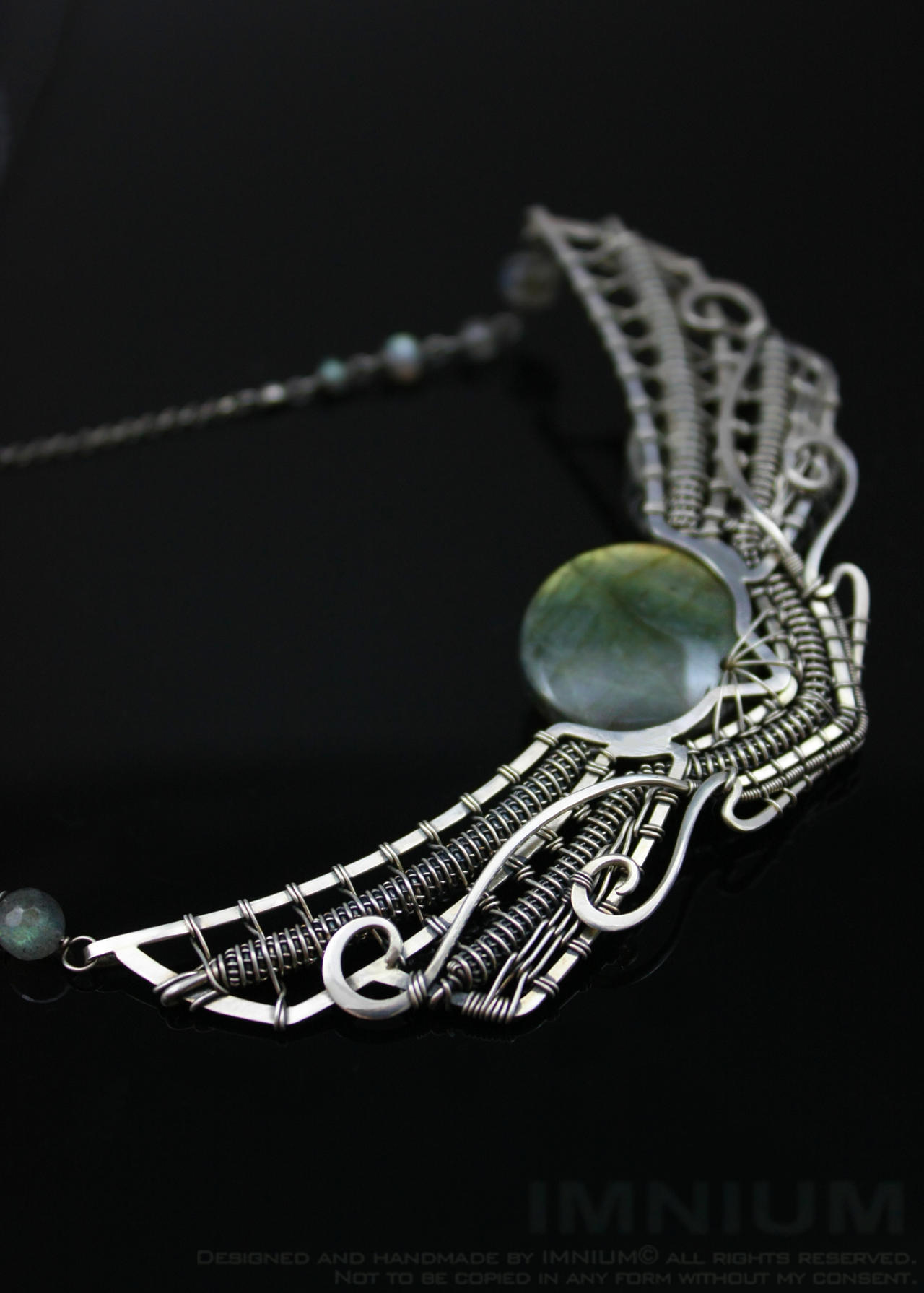 Winged sun necklace II by IMNIUM