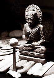 buddha with rocks by qubelee