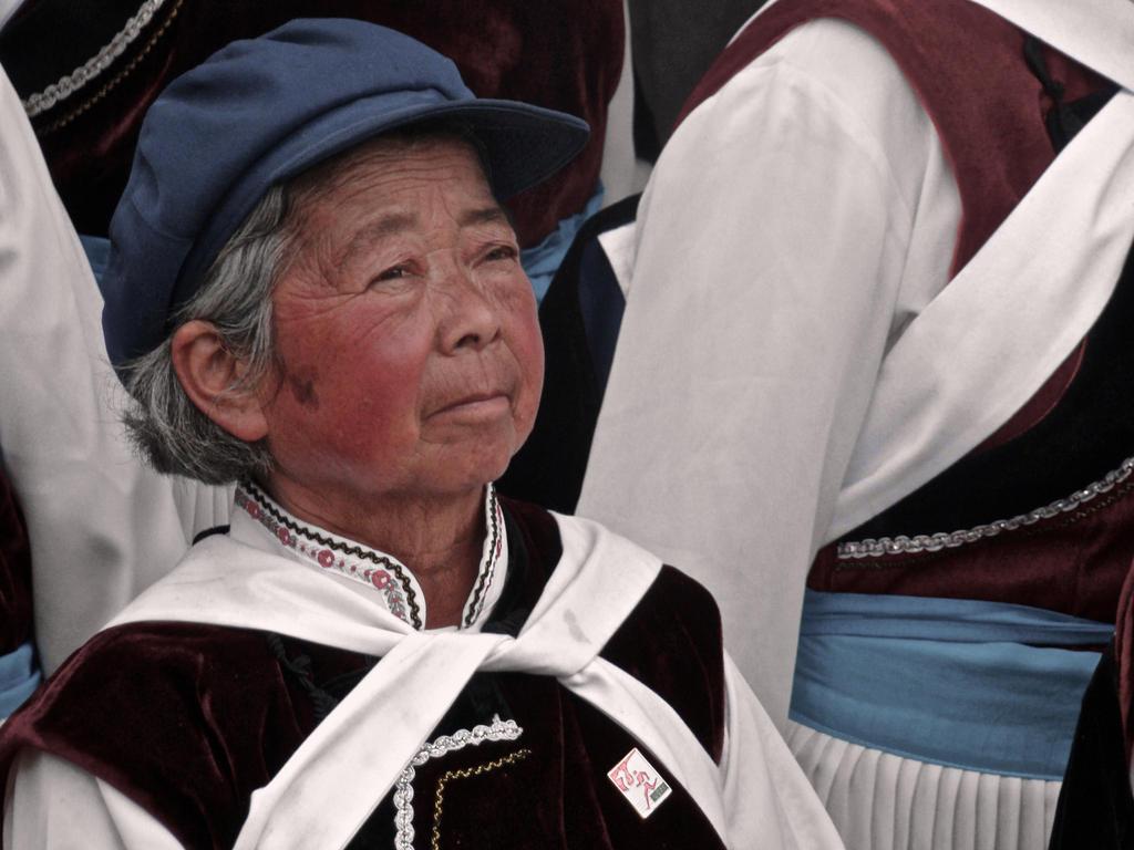 Portrait of a Naxi Dancer by xofox