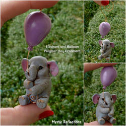 Elephant holding Balloon