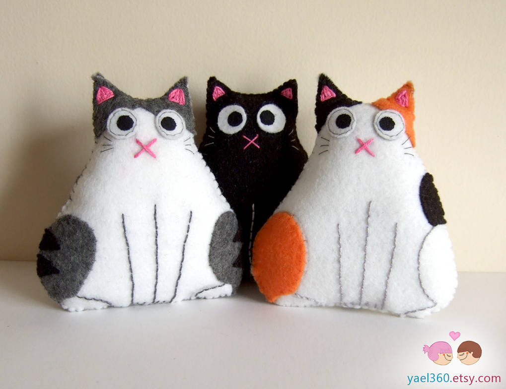 Trio of fat cats: black, tabby and white, and cali