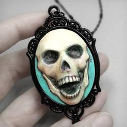 Aqua Skull Cameo Necklace by True-Crimeberry