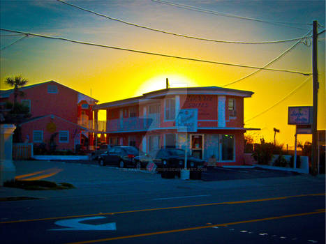 Small Motel On The Beach At Sunrise