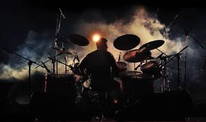 Man Behind The Drum.