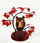 Origami owl in a maple tree