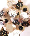 Angular cat head enamel pins on Etsy!