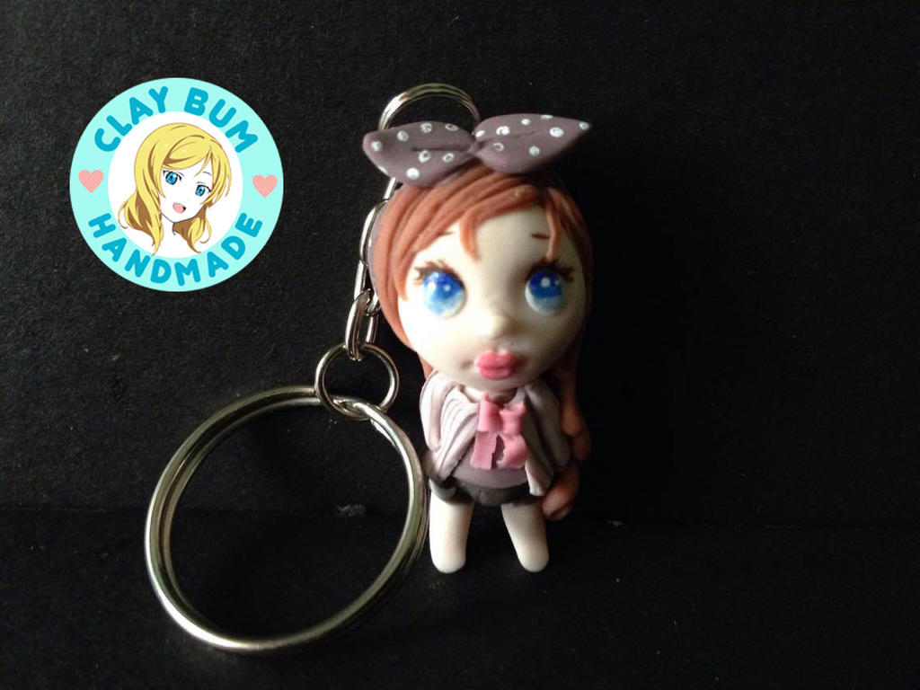 kawaii lady keychain made from cold porcelain clay by