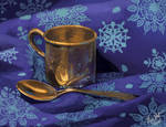 Silver spoon and cup still life