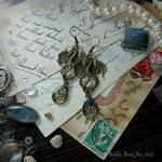 Long steampunk earrings with dragons