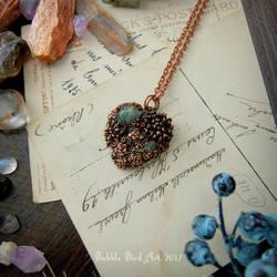 Heart-shaped copper pendant with succulents by IkushIkush