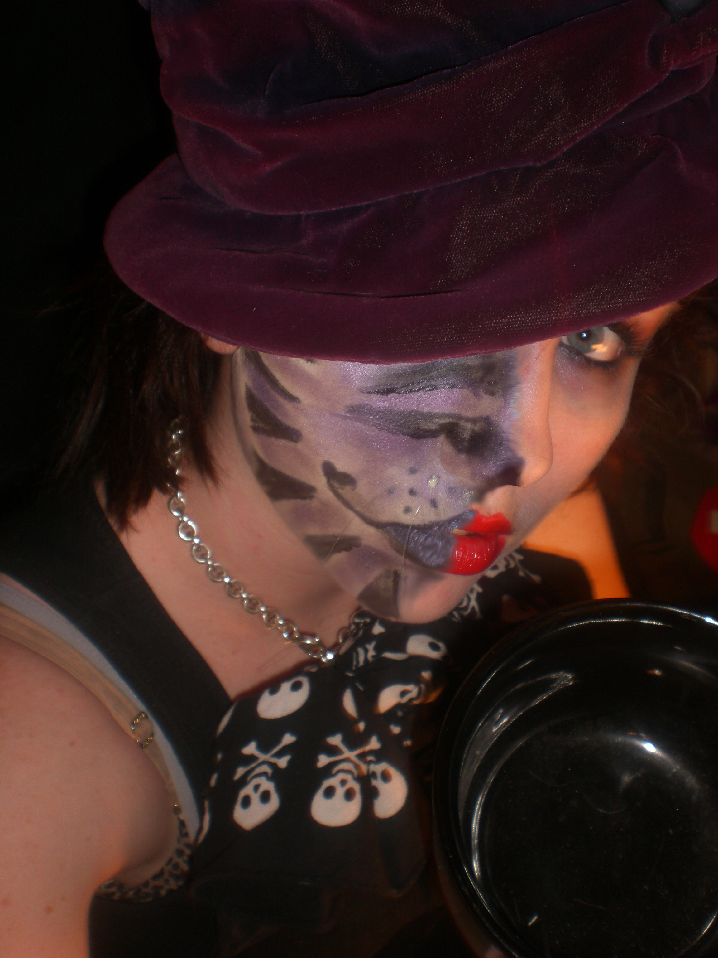 hatter with a Cheshire grin