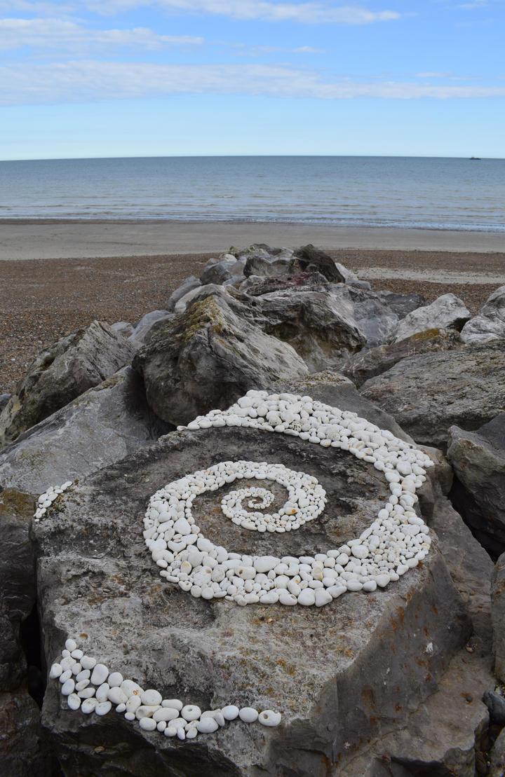 Chalk pebble rock swirl by Dishtwiner