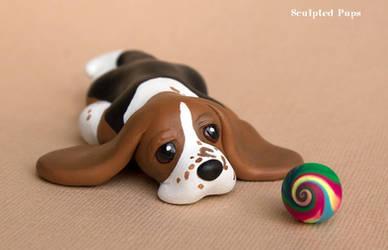 Bored Basset hound pup sculpture