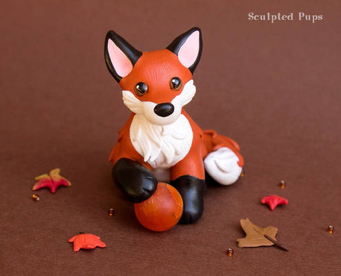 Red Fox with a fire sphere sculpture