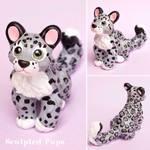 Snow leopard cub sculpture