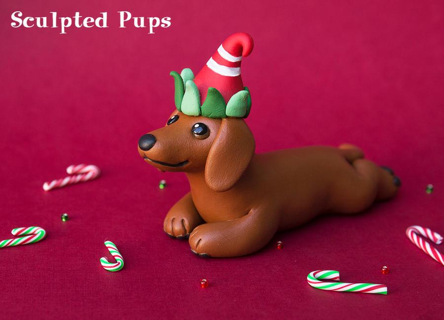 Dachshund with an elf hat by SculptedPups