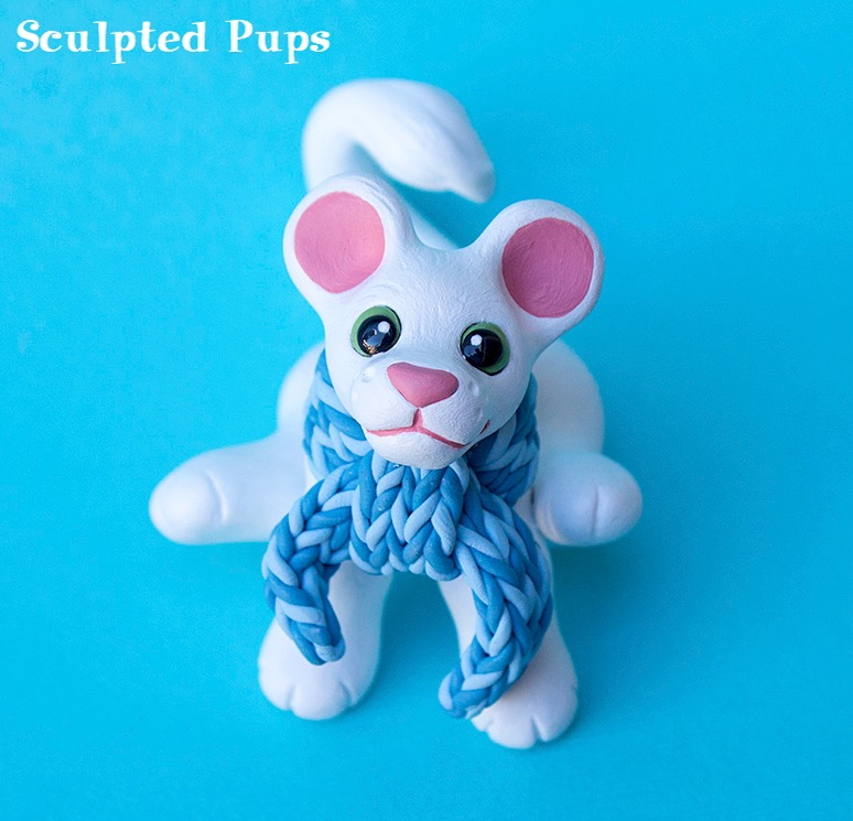 White lion cub sculpture with scarf by SculptedPups