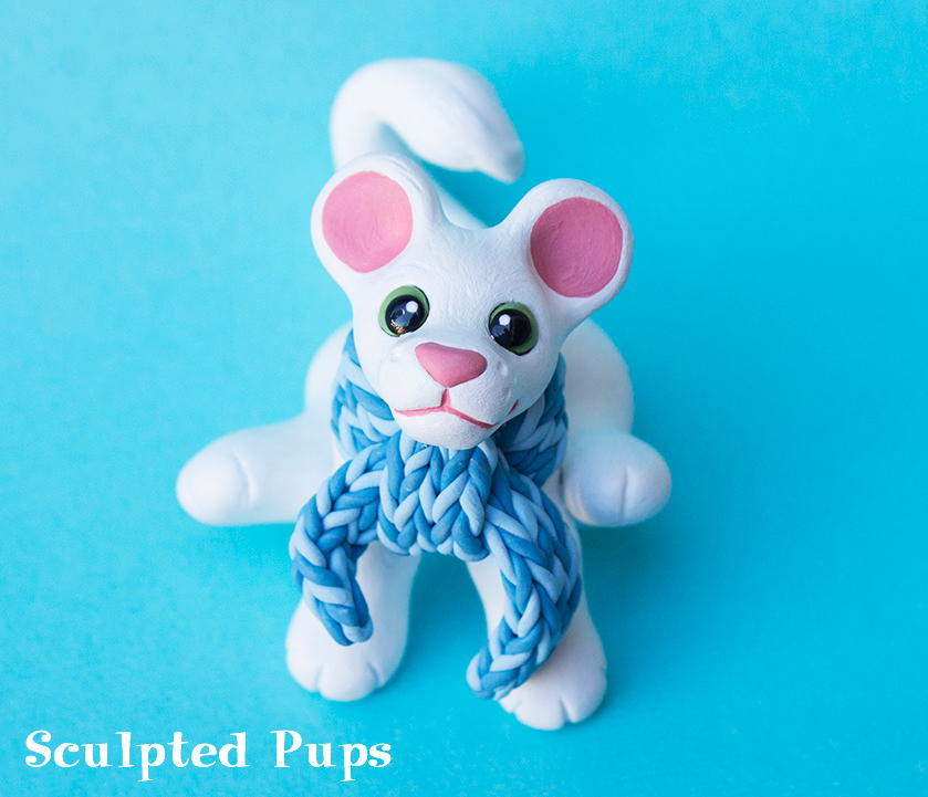 White lion with scarf sculpture by SculptedPups