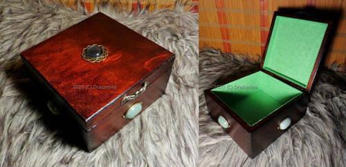 A wooden tarot box with aventurine