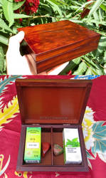 A wooden box for essence oils and natural stones