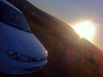 Car under sunset
