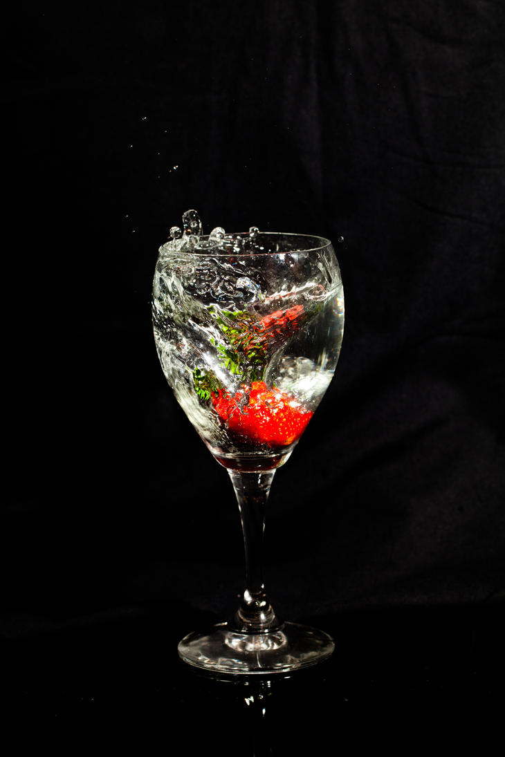 A glass of water with a strawberry 1 by MultimediaNaranja