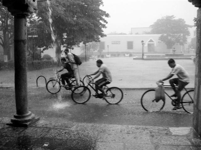 biking in the rain by eyepollution on deviantart