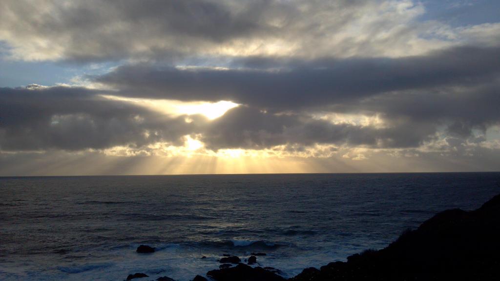 Cloud hidden sun at Pacific shore