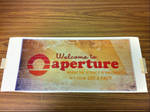 Welcome to Aperture - 70's sign printout.