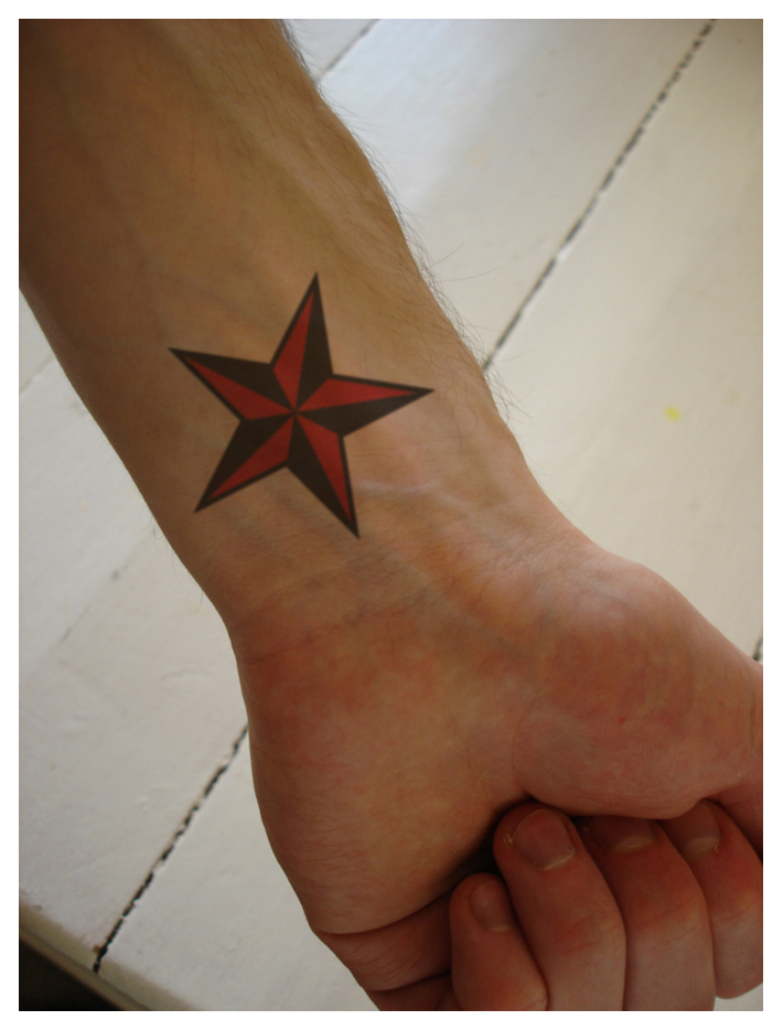 tattoos on wrist stars. star wrist tattoos.