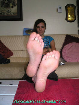 Teen soles crossed at the ankles
