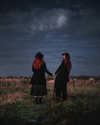 Two redheads under the thunderstorm sky
