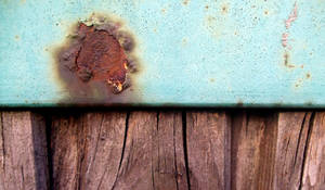 Blue paint, rusty stain and wood texture