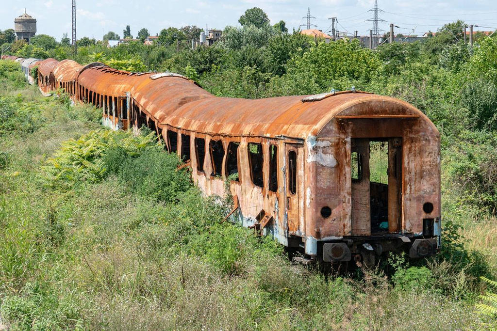 Abandoned passenger cars in Timisoara, Romania. by FutureWGworker