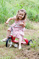 Little girl with bicycle by Bodhichita