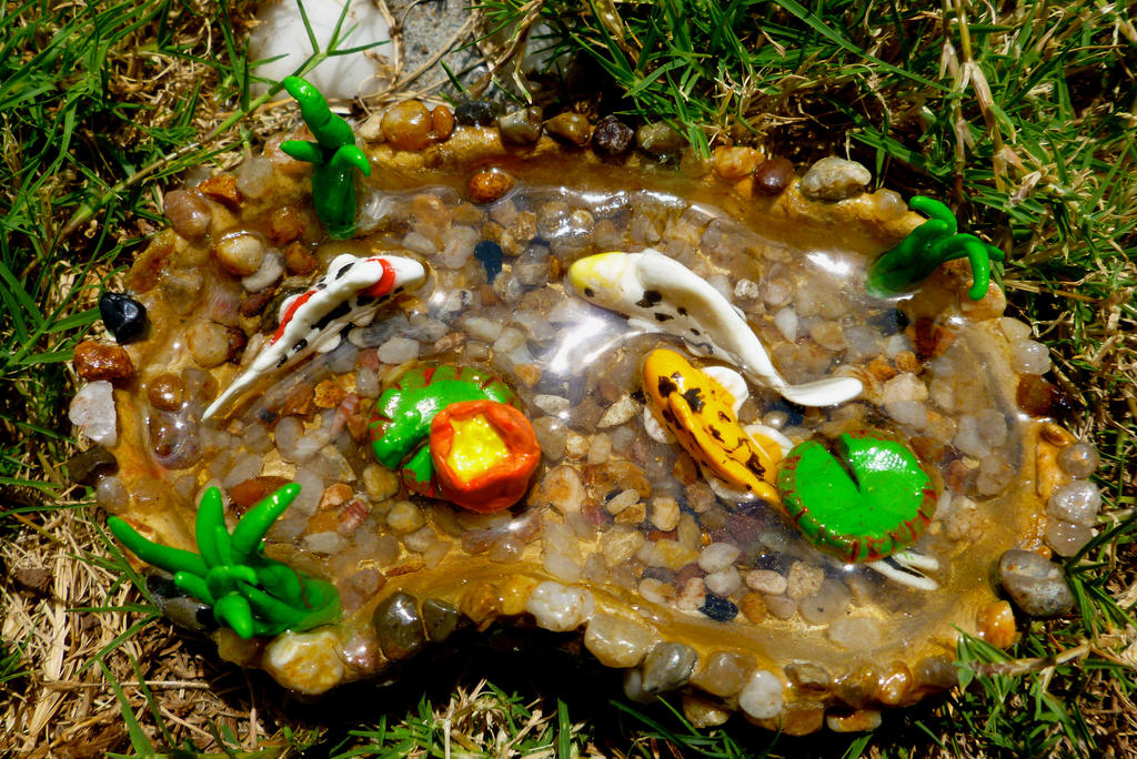 Miniature glow in the dark mixed koi pond by puffugu on for Miniature fish pond