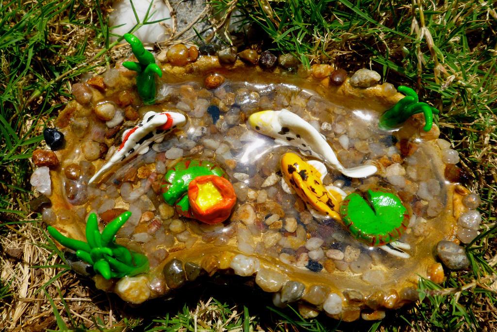 Miniature glow in the dark mixed koi pond by puffugu on for Mini koi pond