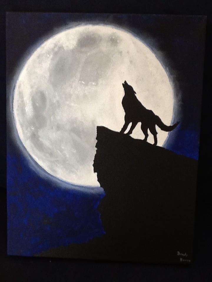 Black wolf howling at moon - photo#12
