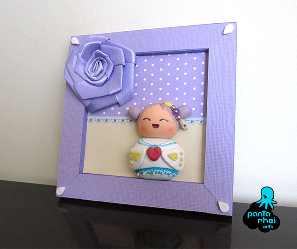 Cold porcelain, wood and paper: Kokeshi frame by pantarheiarts