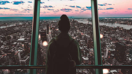 girl looking at the city 's window