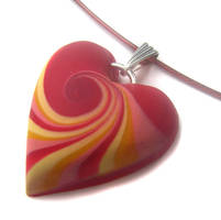 Red polymer clay necklace by fairy-cakes