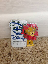 Disney conservation fund pin with Simba on it
