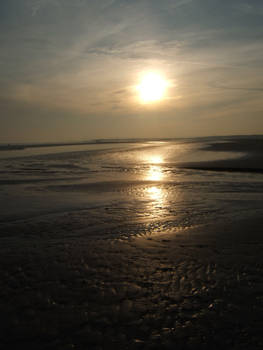 The sun sets at Camber Sands